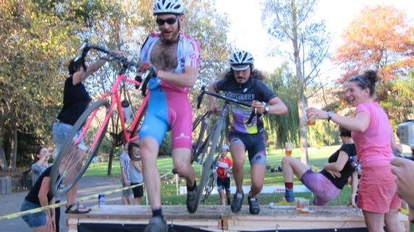 Men's B Race get hand-ups in the Jortz + Superpro Racing Beer Gauntlet on the Barrier of Unreasonable Height.