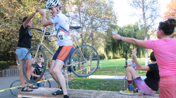 Men's B Race get hand-ups in the Jortz + Superpro Racing Beer Gauntlet on the Barrier of Unreasonable Height.